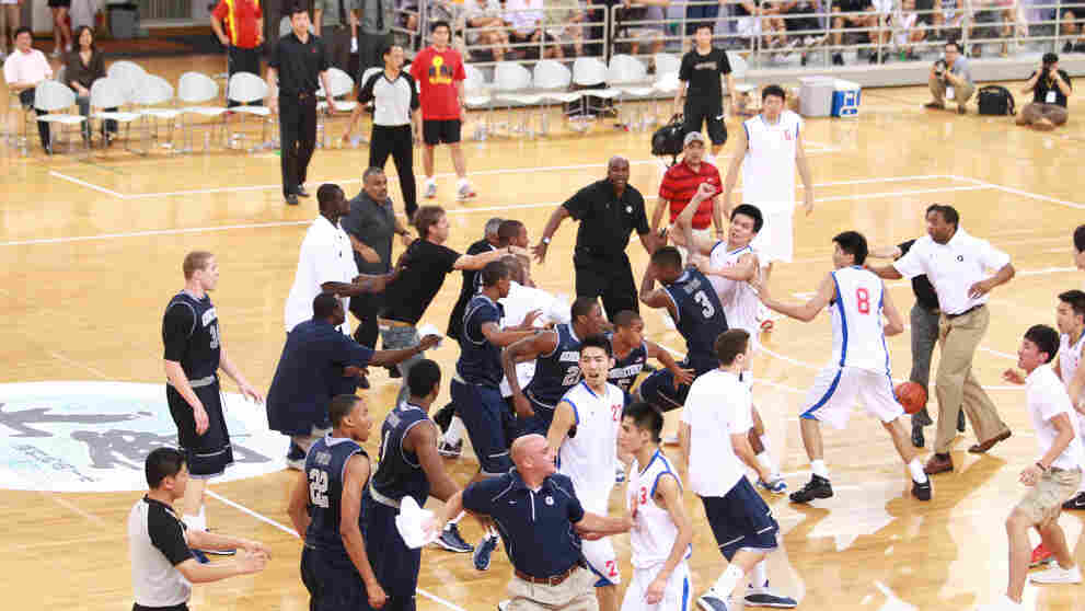 Basketball players from Georgetown University and China's Bayi Rockets team traded punches during their game Thursday (Aug. 18, 2011) in Beiing.