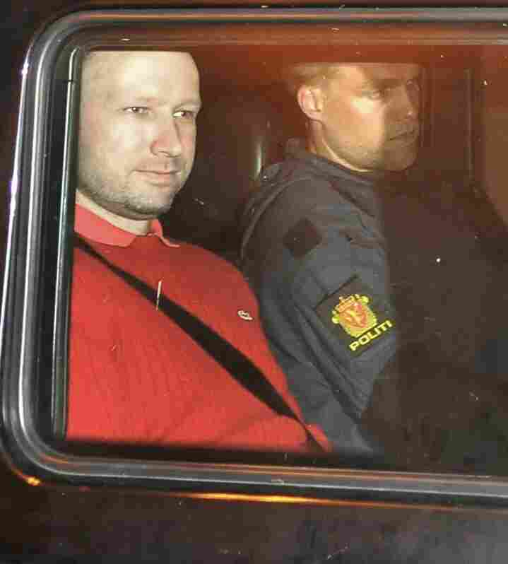 Bomb and terror suspect Anders Behring Breivik (red top) leaves the courthouse in a police car  in Oslo on July 25, 2011.