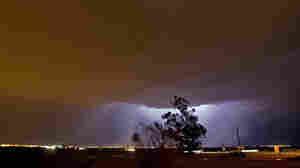 Lightning reveals a large layer of dust in the sky Thursday (Aug. 18, 2011) in Gilbert, Ariz.