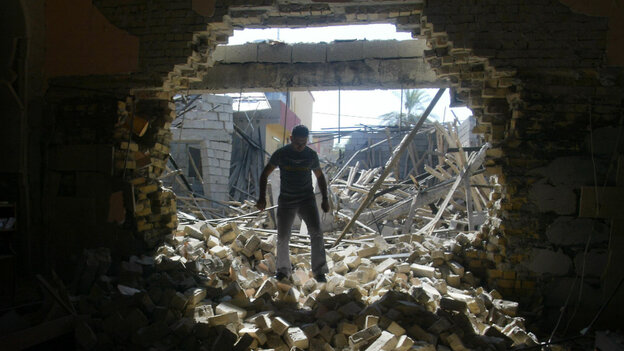 An Iraqi man inspects damages at the Mar Afram Syriac Orthodox Church after an explosion in the northern city of Kirkuk on Aug. 15. Iraq continues to be hit by violence as most U.S. forces prepare to leave by the end of the year.