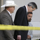 Warren Jeffs, center, leaving a courthouse in San Angelo, Texas, on Aug. 4, 2011.