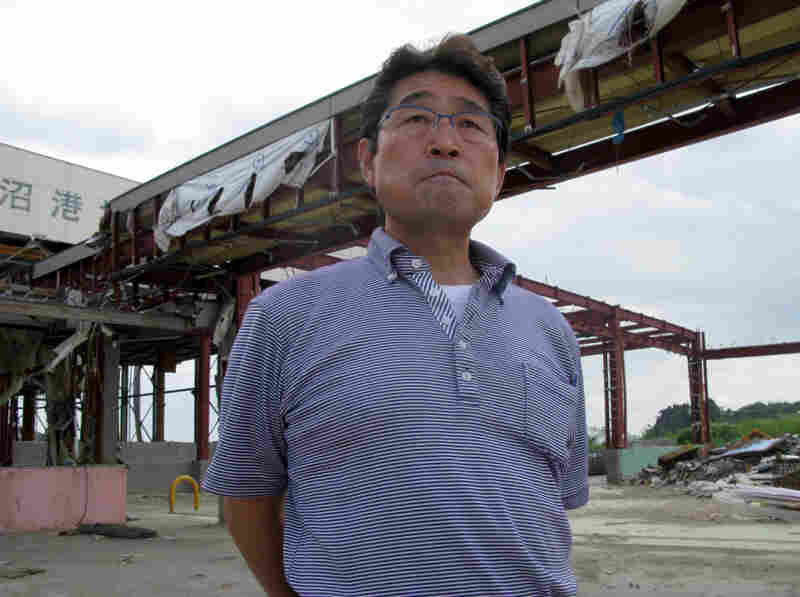 Mitsuo Iwabuchi stands in one of his ruined fish processing plants. The regional government won't allow reconstruction to begin without a plan to cope with flooding. The quake actually lowered Kesennuma closer to the sea, and the fishing port floods when the tide comes in.
