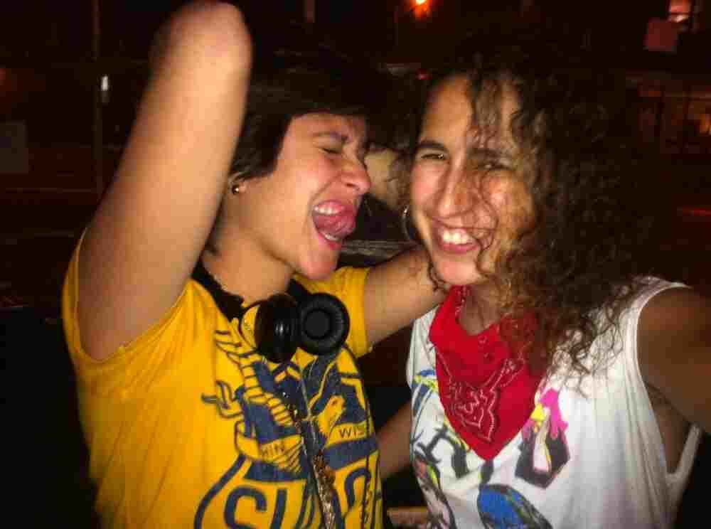 DJ Mafe (left) and DJ Rat revel in a recent Latin alternative dance party.