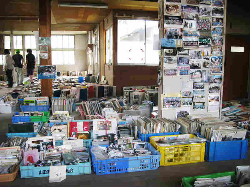 The tsunami  washed away countless homes, but thousands of photos were recovered amid the mud and wreckage in Yamada. These photos are waiting for their owners to reclaim  them.