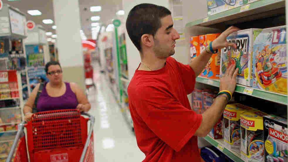 Christian Hernandez stocks shelves earlier this month at a Target store in Miami. Target reported strong profit numbers in the second quarter of 2011 in its continued battle with Walmart stores over discount retail dominance.