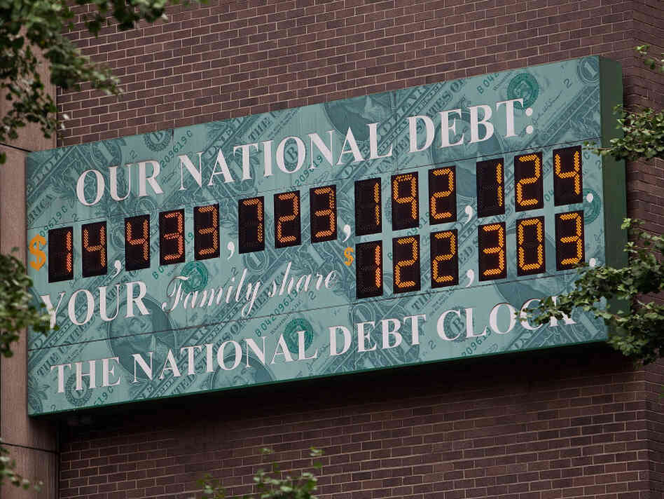 $14.4 trillion and counting: The National Debt Clock, a billboard-size digital display showing the increasing U.S. debt, is seen in New York City on Aug. 1.