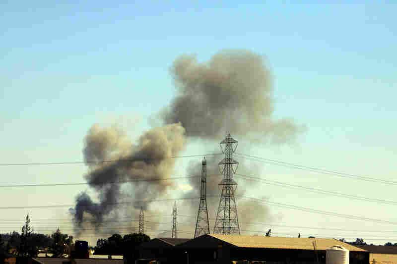 Smoke billows from Tajura, a suburb of Tripoli, following a NATO airstrike on Thursday.