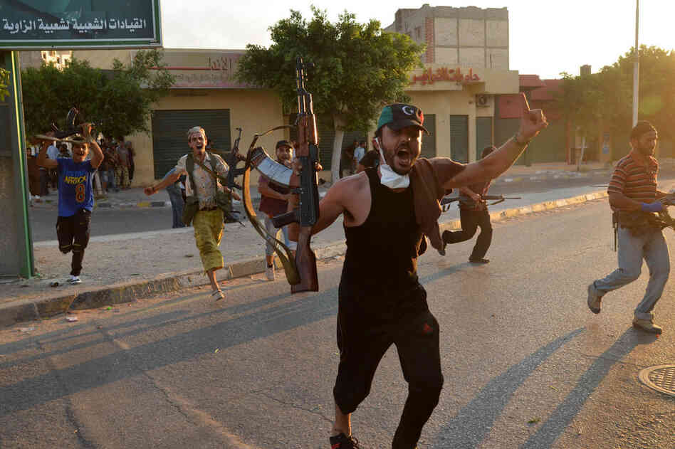 Libyan rebels celebrate after gaining positions against regime forces in Zawiya on Friday.