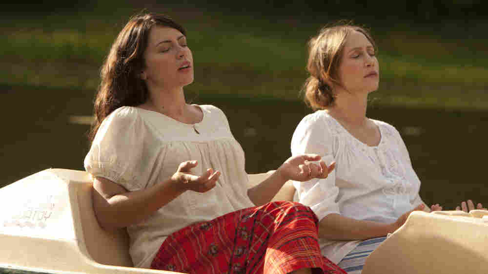 Keep On The Sunny Side: Corinne Walker (Vera Farmiga, right), an increasingly skeptical member of an isolating Christian society, finds comfort in her friend Annika (Dagmara Dominczyk) as the two search for spiritual meaning together.