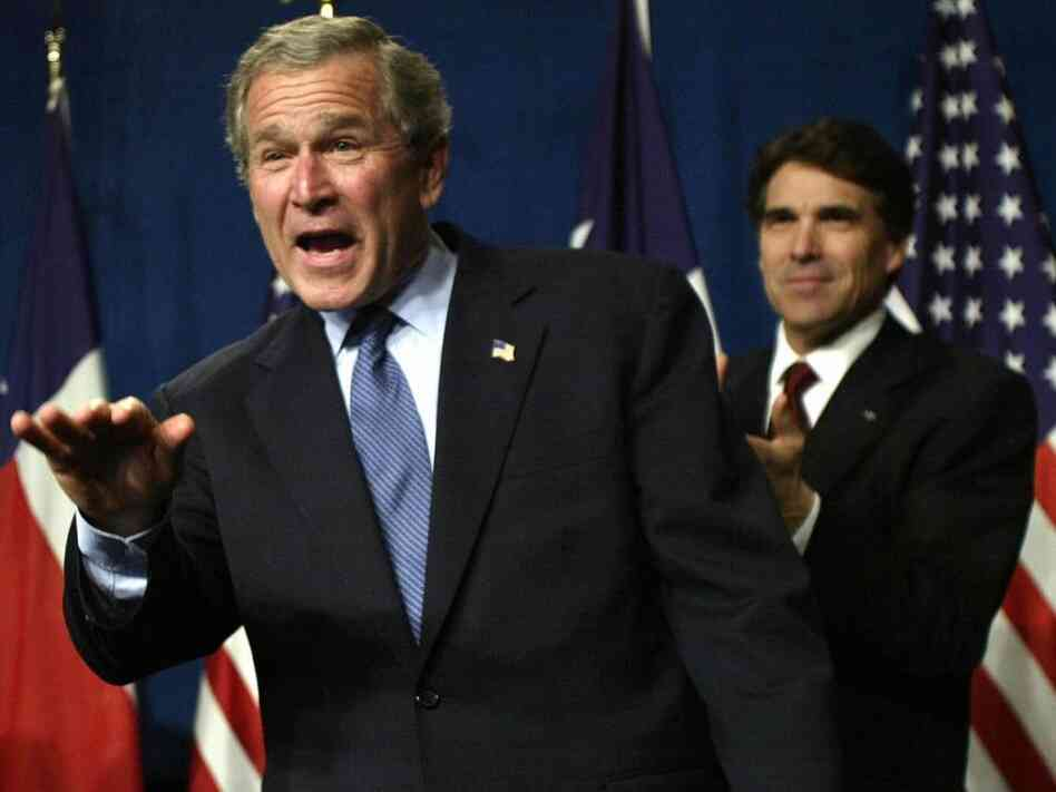 Then President George W. Bush waves as he takes the stage during a Bush-Cheney 2004 reception with Texas Governor Rick Perry at the Hilton Americas  in March 2004 in Houston, Texas. Perry is now considered a front runner for the 2012 GOP presidential nomination.