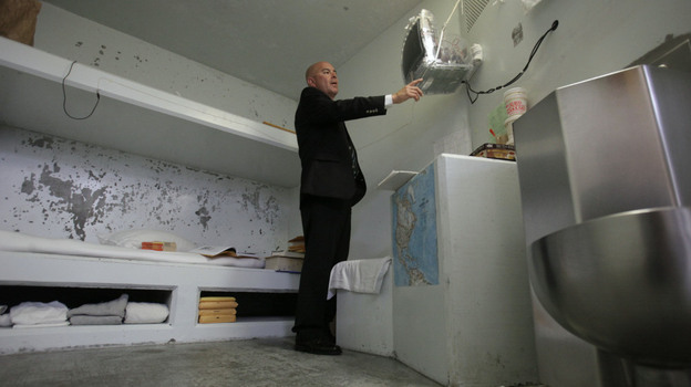 Correctional Officer Lt. Christopher Acosta  turns on a television in a cell in the Secure Housing Unit at Pelican Bay State Prison near Crescent City, Calif., on Aug. 17.  State prison officials allowed the media to tour Pelican Bay's SHU, where inmates are isolated. (AP)