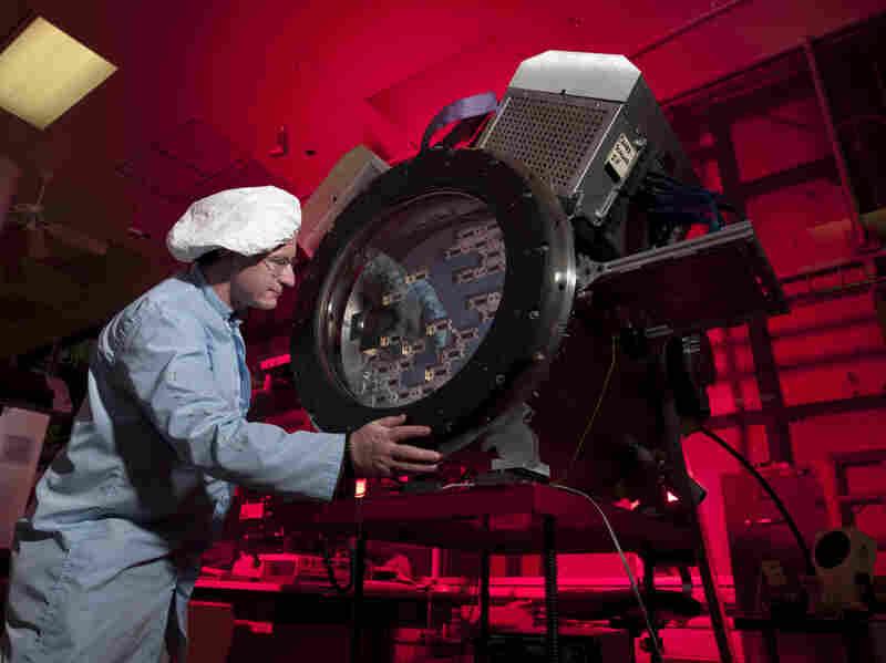 Fermilab scientist Tom Diehl works on the heart of the Dark Energy Camera.