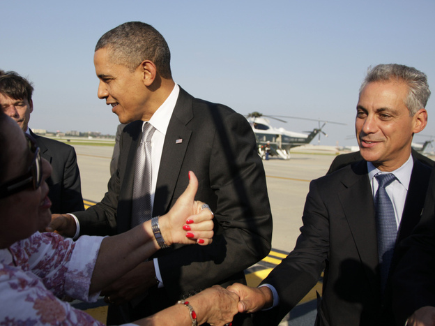 Emanuel and President Obama greet people on the tarmac as the president arrives at Chicago's O'Hare International Airport earlier this month. Emanuel still informally advises the president but says he has no regrets leaving the White House.