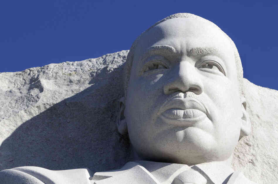 The statue of Dr. Martin Luther King, Jr. is seen unveiled from scaffolding during the soft opening of the Martin Luther King, Jr. Memorial in Washington on Monday.
