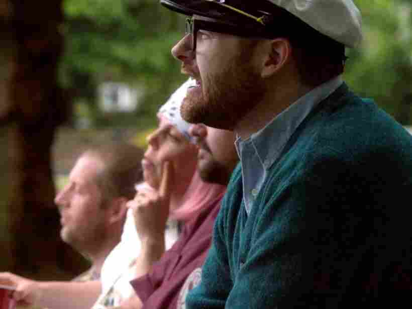 The Decemberists watch a dystopic tennis match.