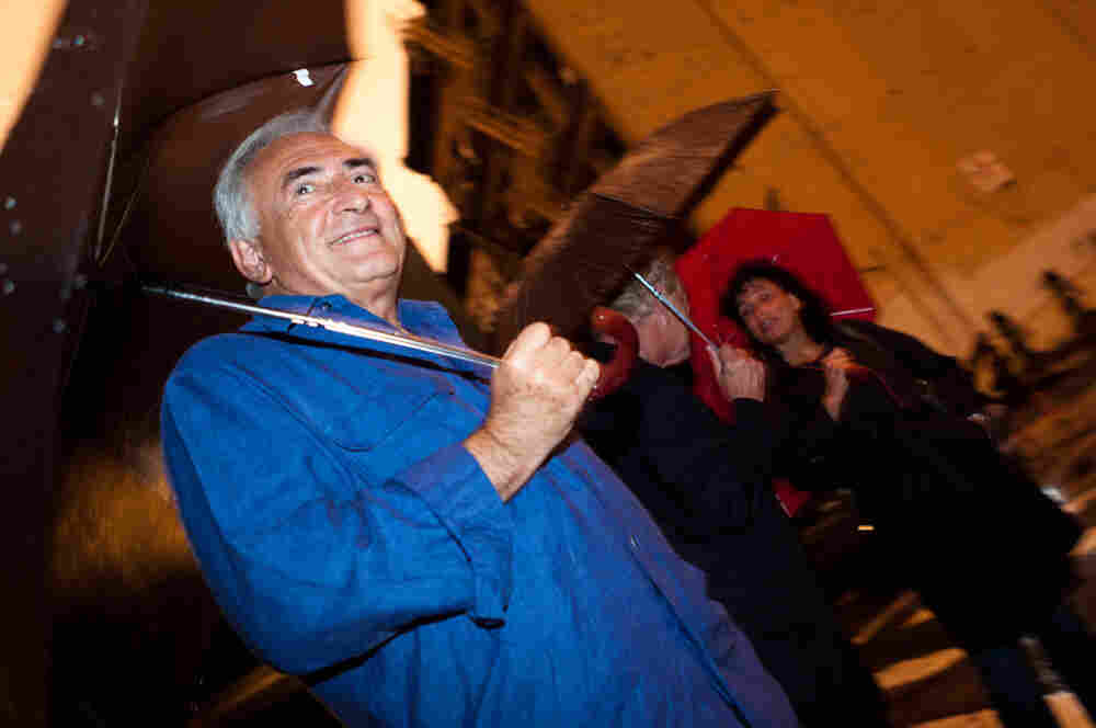 Former IMF head Dominique Strauss-Kahn waits for a taxi near his temporary residence in Tribeca neighborhood of New York.