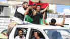 In Tripoli: Rebels, Snipers, Chaos