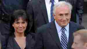 """Former IMF head Dominique Strauss-Kahn and his wife, Anne Sinclair, leave a hearing at New York State Supreme Court on Tuesday after a judge dismissed sex charges against him. Strauss-Kahn thanked supporters and said that the period since his arrest had been a """"nightmare."""""""