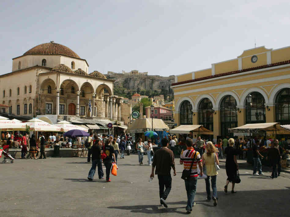 Athens' Monastiraki neighborhood is a meeting place for Greek and Ottoman culture. Case in point: the 18th-century Tzistarakis Mosque (left) sits below the Acropolis (center) and serves as a focal point for Monastiraki Square.