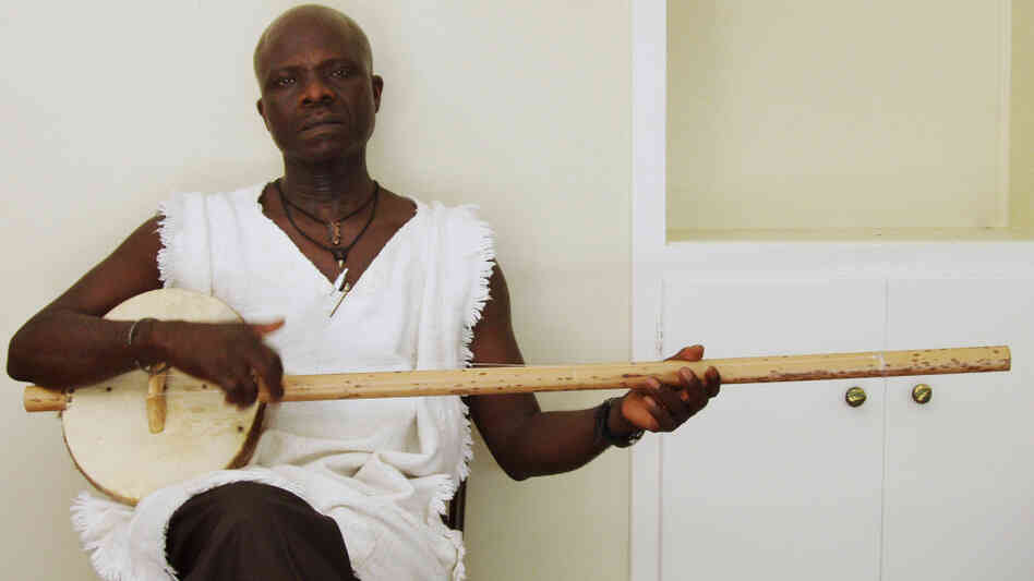 Laemouahuma Daniel Jatta plays the akonting, an African instrument that may be a precursor to the banjo.