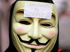 A demonstrator wears a mask during a protest inside the Bay Area Rapid Transit (BART).