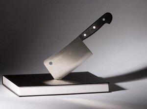 A butcher knife stuck in a book
