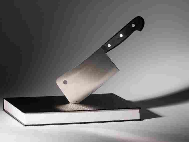 A butcher knife stuck in a book