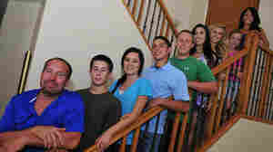 The cast of Downsized: Todd Bruce, his seven children and stepchildren, and his wife Laura.