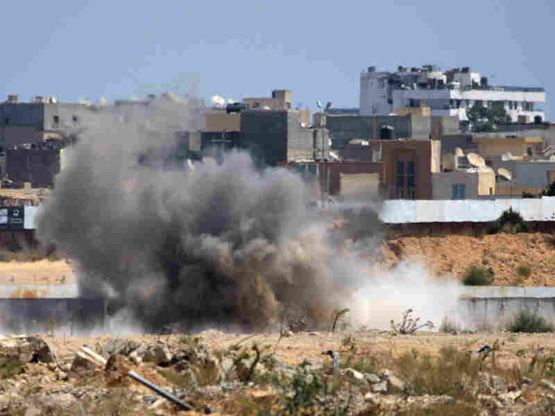 An explosion hit near Moammar Gadhafi's Bab al-Aziziya compound in Tripoli on Tuesday as new battles erupted in the Libyan capital.
