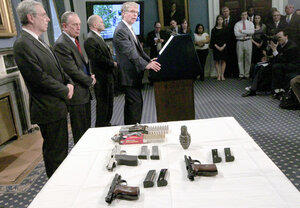 NYPD Deputy Commissioner for Intelligence David Cohen (far left) stands with other city officials to announce a foiled terrorist plot against a New York synagogue on May 12.
