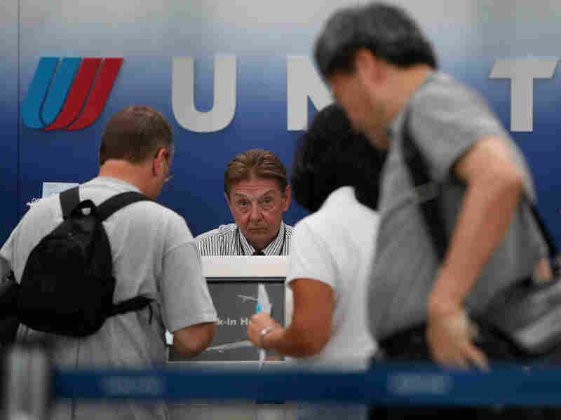 Passengers wait in line at the United Airlines terminal at Chicago's O'Hare airport in 2009 after a computer malfunction caused long delays and the cancellation of some United flights.