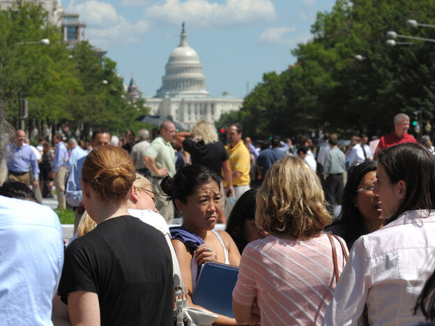 People gather on Freedom Plaza in Washington, D.C., after a earthquake on Tuesday.