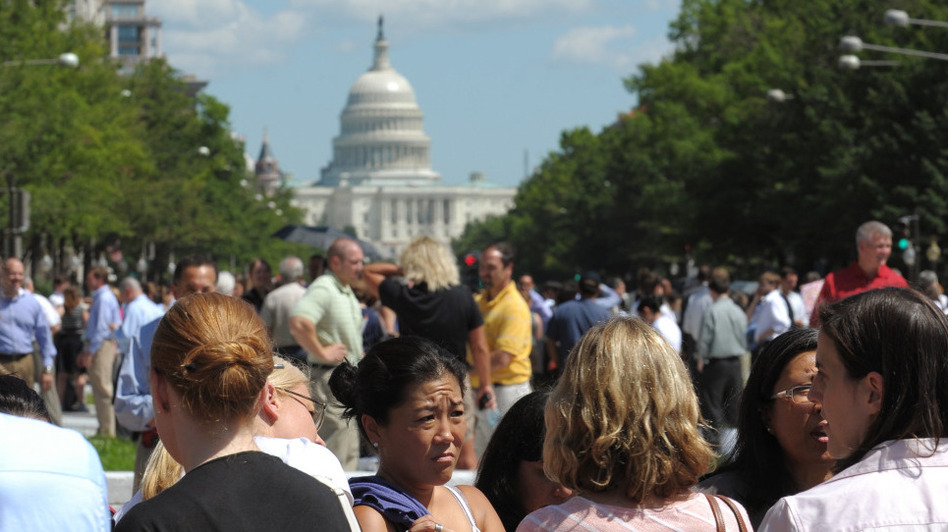 People gather on Freedom Plaza in Washington, D.C., after a earthquake on Tuesday. (AFP/Getty Images)