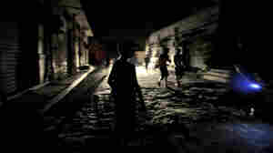 Young boys on a dark street in Tripoli late last night (Aug. 22, 2011). Fighting flared again today in the Libyan capital.