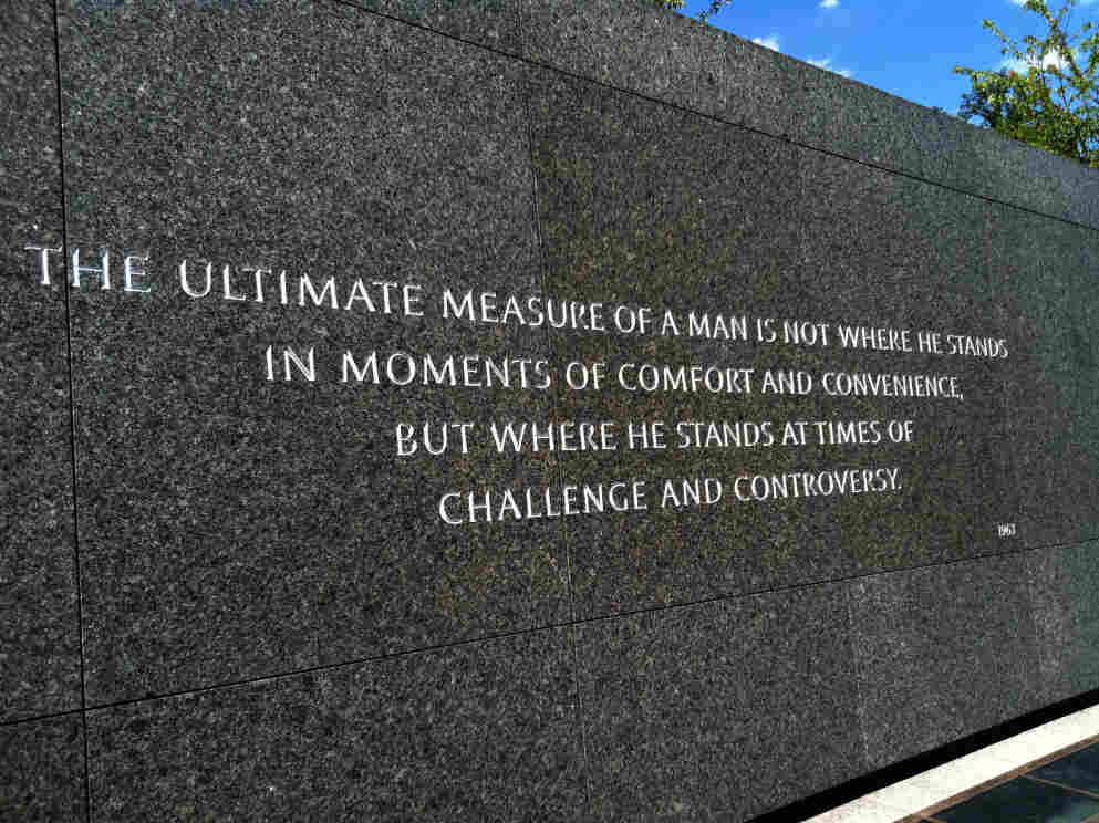 """One of Martin Luther King Jr.'s famous quotes is inscribed along a wall at the slain civil rights leader's new national memorial. The quote says, """"The ultimate measure of a man is not where he stands in moments of comfort and convenience, but where he stands at times of challenge and controversy."""""""