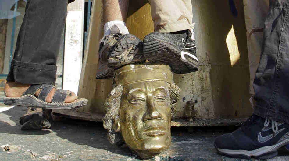 Some Libyans used their feet — in a grave insult — to show their contempt for Moammar Gadhafi during the looting of his compound in Tripoli on Tuesday.