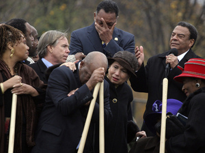 Andrew Young (top right) speaks about the significance of the Rev. Martin Luther King Jr. at the groundbreaking for the memorial in Washington, D.C., on Nov. 13, 2006. Also present are other King lieutenants, including the Rev. Jesse Jackson (top center) and Georgia Rep. John Lewis (leaning on shovel).
