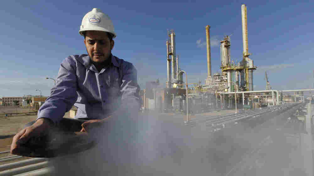 A Libyan oil worker at a refinery inside the Brega oil complex, in eastern Libya, on Feb. 26. Production at Brega has dropped by almost 90 percent amid the country's crisis because many employees have fled, and few ships are coming to the port.