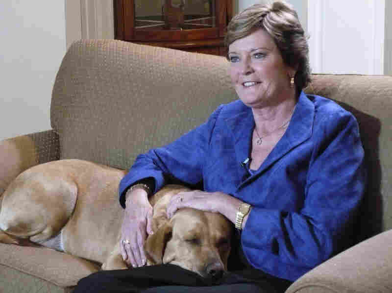 "Tennessee women's basketball coach Pat Summitt sits with her dog at her home in Knoxville, Tenn. Summitt plans to coach ""as long as the good Lord is willing"" despite recently being diagnosed with early onset dementia."