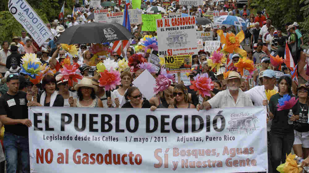 Demonstrators march during a May 1 protest against the proposed construction of a 92-mile gas pipeline in Adjuntas, Puerto Rico. Puerto Rico Gov. Luis Fortuno has made the project a central goal of his administration, despite protest from communities affected.