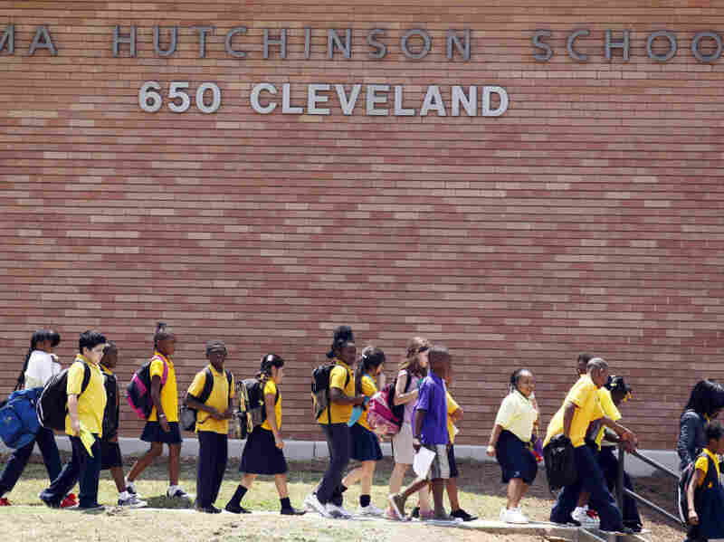 Students leave Atlanta's Emma Hutchinson School in July. Hutchinson is a year-round school that has been identified as one of 44 schools involved in a test cheating scandal.