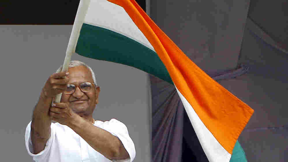 India's anti-corruption activist Anna Hazare waves an Indian flag during his hunger strike in New Delhi, India on Thursday.