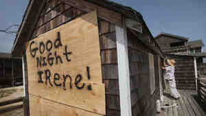 Fen Rascoe boards up his parents' cottage as they prepare for Hurricane Irene on Thursday in Nags Head, N.C., which is under a mandatory evacuation order.