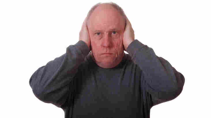 A man covering his ears.