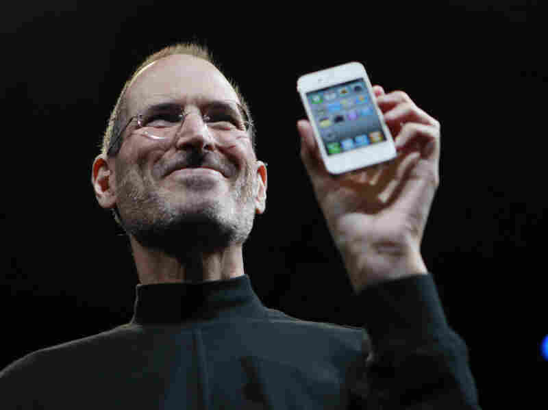 Steve Jobs,  the  now-former CEO of Apple, holds up an iPhone at the Apple Worldwide   Developers Conference in San  Francisco in June 2010. Jobs announced on  Wednesday that  he would be resigning as CEO of Apple.