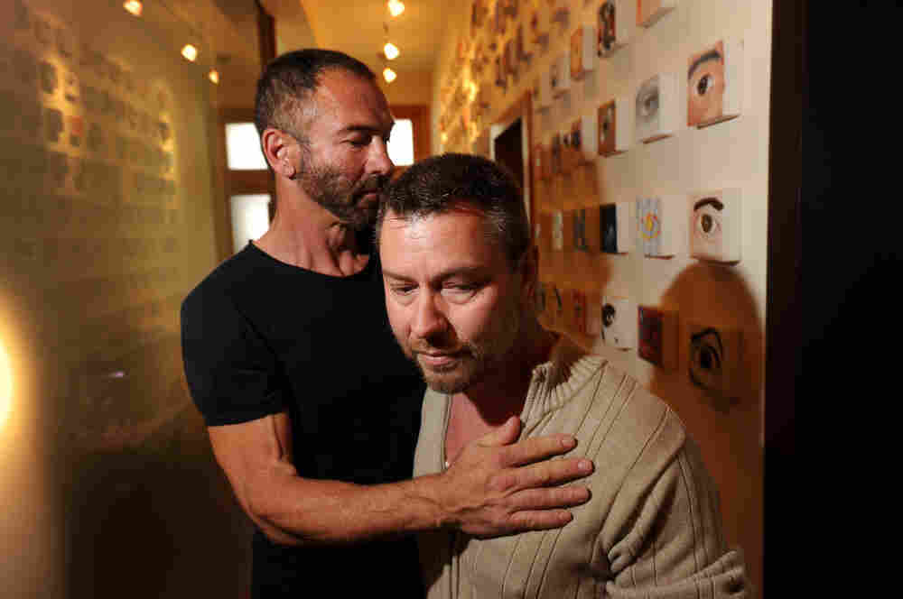 Anthony Makk (right)  and husband Bradford Wells at their San  Francisco home on Aug. 8. Though legally married in 2004,  Makk faces deportation back to his native Australia.