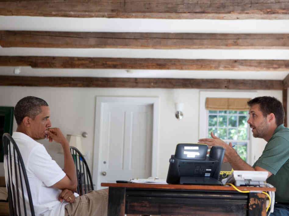 President Obama is briefed by Brian Deese, National Economic Council deputy director, Martha's Vineyard, MA, Aug. 24, 2011.