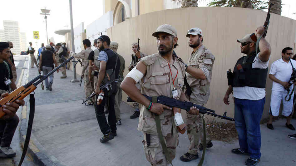 In Tripoli on Wednesday (Aug. 24, 2011), opposition fighters searched for Moammar Gadhafi and his relatives.