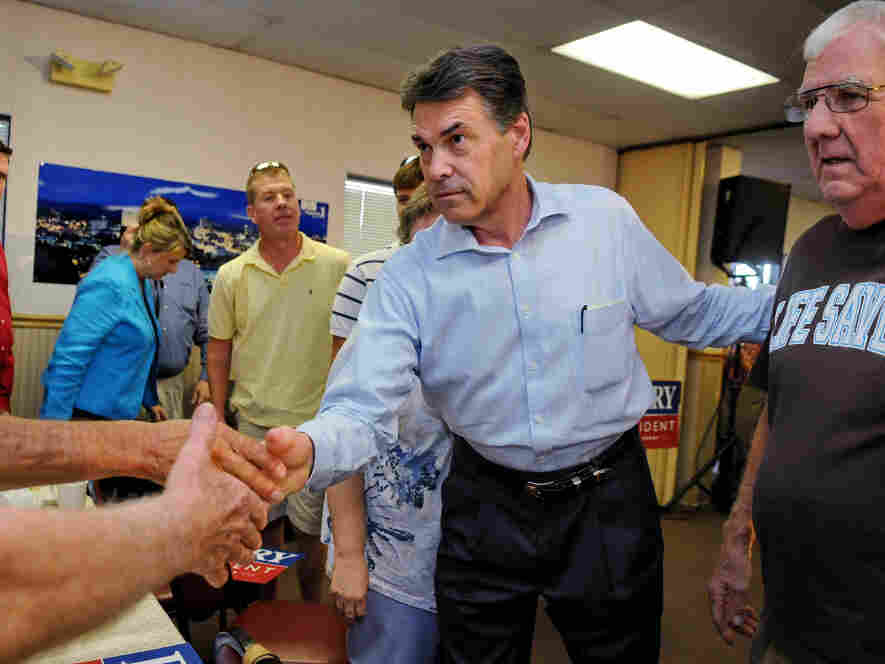 Texas Gov. Rick Perry greets supporters at Tommy's Ham House in Greenville, SC, Aug. 20, 2011.