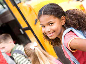A girl in line for the school bus.